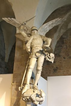 a stone statue of Saint Michael in Mont Saint Michel in paris