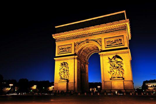 night view of Arc de Triomphe in paris