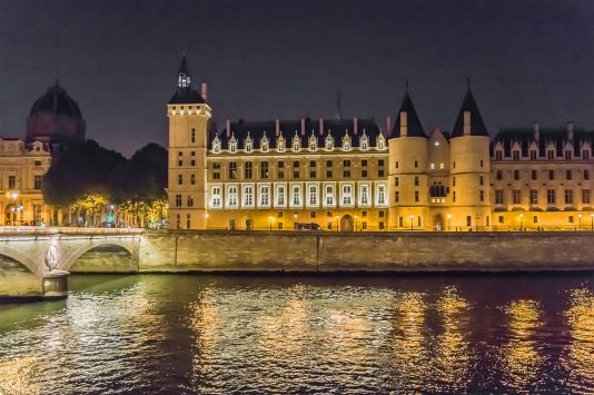 night view of Conciergerie in paris